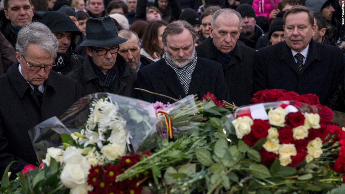 A group of European Union ambassadors to Russia lay flowers on February 28 at the site where Nemtsov was gunned down in Moscow.