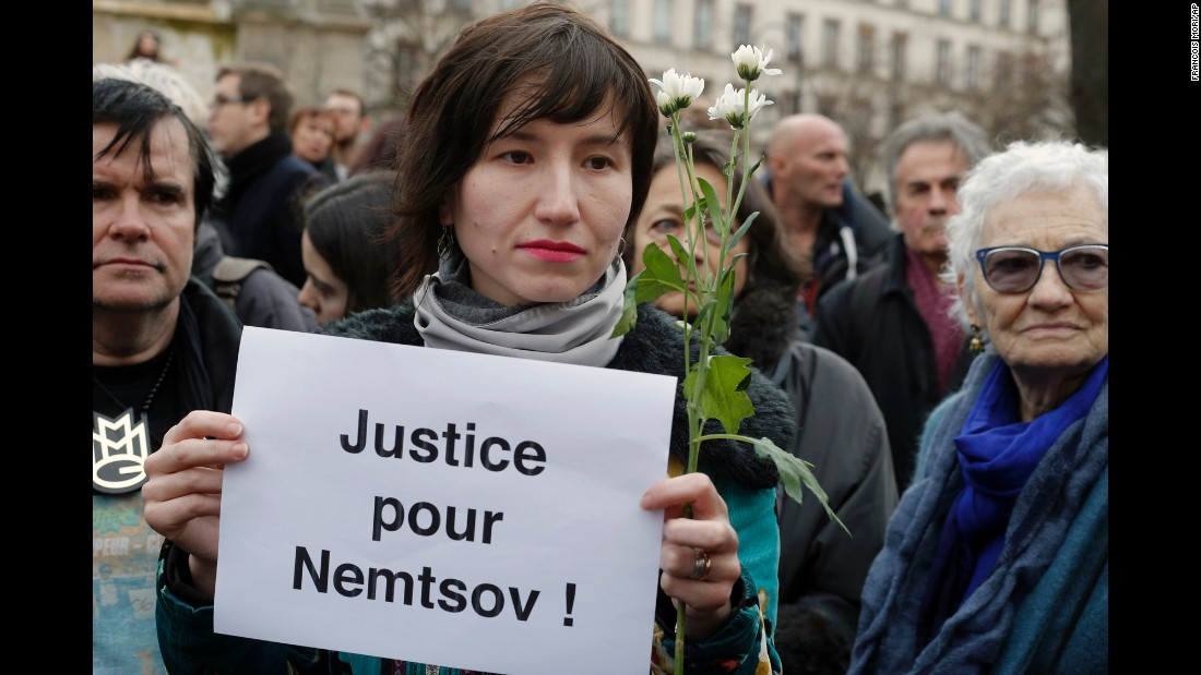 People gather at Innocent Plaza in Paris on March 1 to remember Nemtsov.