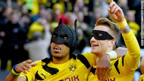 Aubameyang and Marco Reus celebrate as Batman and Robin after scoring against Schalke last year.