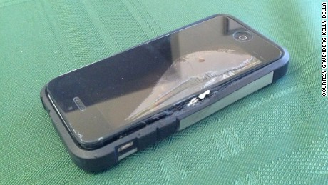 The damaged phone that Erik Johnson says burned his leg when it exploded in his pocket.