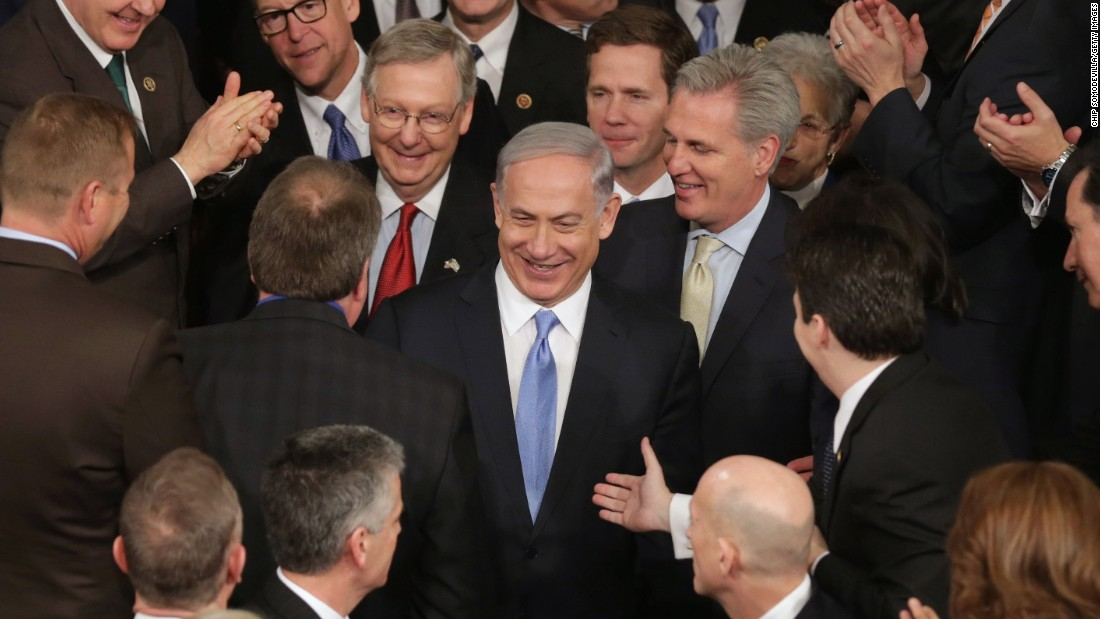 Netanyahu is greeted by members of Congress as he arrives to speak in the House chamber on Tuesday, March 3.