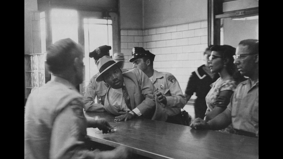 The Rev. Martin Luther King Jr. is arrested for loitering outside a courtroom where his friend Ralph Abernathy was appearing for a trial in 1958.