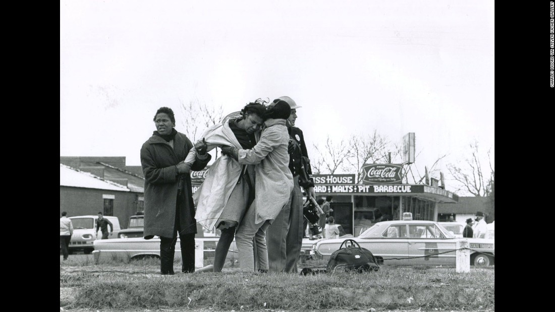 "Activist Amelia Boynton is helped to her feet after being knocked unconscious by a state trooper. ""The quality, the depth, the sense of reality that (photographer Charlie Moore) brings to the work is unparalleled,"" said Steven Kasher, <a href=""http://www.stevenkasher.com/"" target=""_blank"">whose gallery is showing the Selma images</a> of Moore and other essential witnesses of the civil rights era."