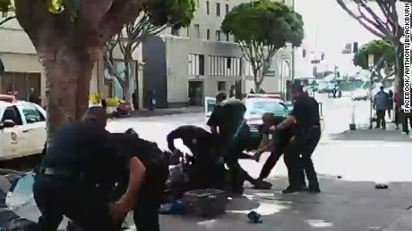 Expert: Man appears to have hand on LAPD officer's gun