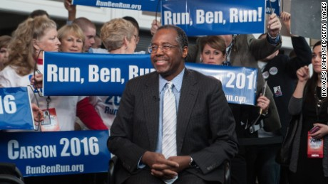 US conservative Ben Carson is surrounded by supporters as he waits to be interviewed at the annual  Conservative Political Action Conference (CPAC) at National Harbor, Maryland, outside Washington,DC on February 26, 2015.    AFP PHOTO/NICHOLAS KAMM        (Photo credit should read NICHOLAS KAMM/AFP/Getty Images)