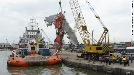 Crews remove the fuselage of AirAsia Flight QZ8501 from a vessel at the Tanjung Priok port in Jakarta, Indonesia, on Monday, March 2.
