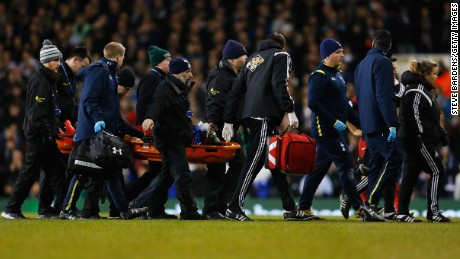 LONDON, ENGLAND - MARCH 04:  Bafetibis Gomis of Swansea City is stretchered off during the Barclays Premier League match between Tottenham Hotspur and Swansea City at White Hart Lane on March 4, 2015 in London, England.  (Photo by Steve Bardens/Getty Images)
