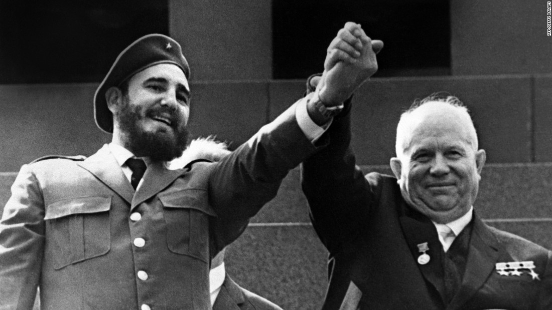 Castro raises arms with Soviet leader Nikita Khrushchev during a four-week visit to Moscow in May 1963.