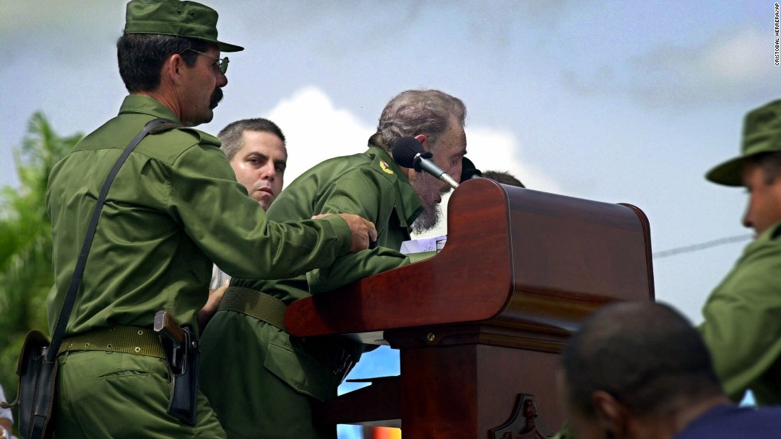 Castro is helped by aides after he appeared to faint while giving a speech in Cotorro, Cuba, in June 2001. He returned to the podium less than 10 minutes later to assure the audience he was fine and that he just needed to get some sleep.