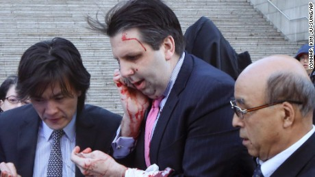 U.S. Ambassador to South Korea Mark Lippert, center, gets into a car to leave for a hospital in Seoul, South Korea, Thursday, March 5, 2015 after being attacked by a man. Lippert was slashed on the face and wrist by a man wielding a blade and screaming that the rival Koreas should be unified, South Korean police said Thursday. (AP Photo/Yonhap, Kim Ju-Sung) KOREA OUT