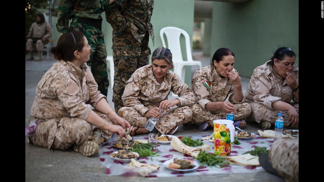 Women gather to eat yaprax, a traditional Kurdish dish.
