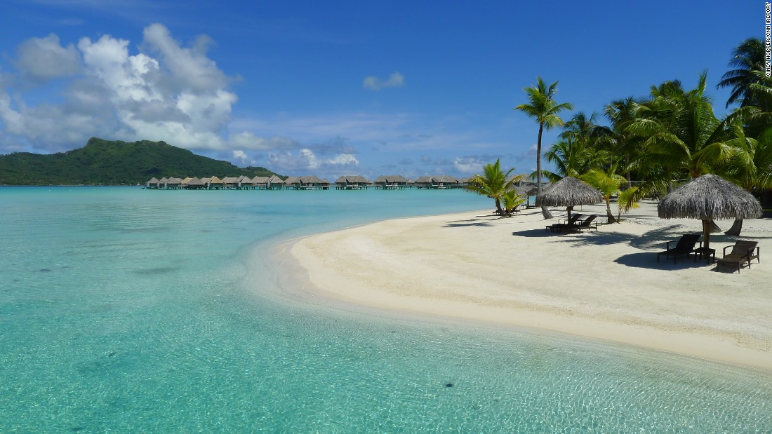 "<a href=""http://ireport.cnn.com/docs/DOC-1082467"">iReporter Cindy Hopper</a> and her husband spent their 34th wedding anniversary in French Polynesia in 2012. Their time on Bora Bora was particularly memorable. ""In those waters, there is no place for any negativity. A true peace,"" she said. Bora Bora is about 165 miles (265 kilometers) northwest of Tahiti in the central South Pacific Ocean."