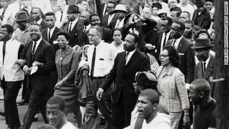 "The Rev. Martin Luther King Jr. arrives in Alabama's state capital at the end of the Selma-to-Montgomery march a few weeks after ""Bloody Sunday."" The Selma campaign is widely considered King's greatest victory."