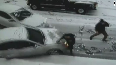 pkg car slides in snow hits person_00001302