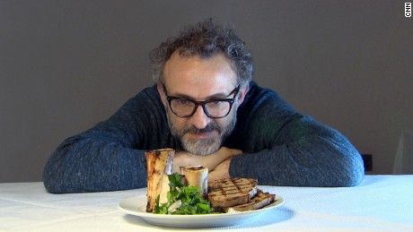 Massimo Bottura contemplates a dish of roasted bone marrow and parsley salad at St. John restaurant. A signature dish, the restaurant gets through 20-30 kilograms of marrow bones daily.