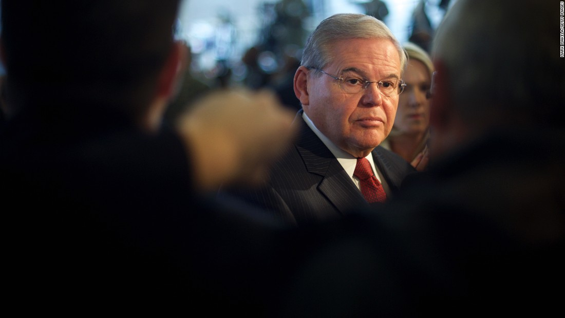 Senator Robert Menendez addresses the media in advance of an event with President Barack Obama December 15, 2014 at Joint Base McGuire-Dix-Lakehurst, New Jersey.