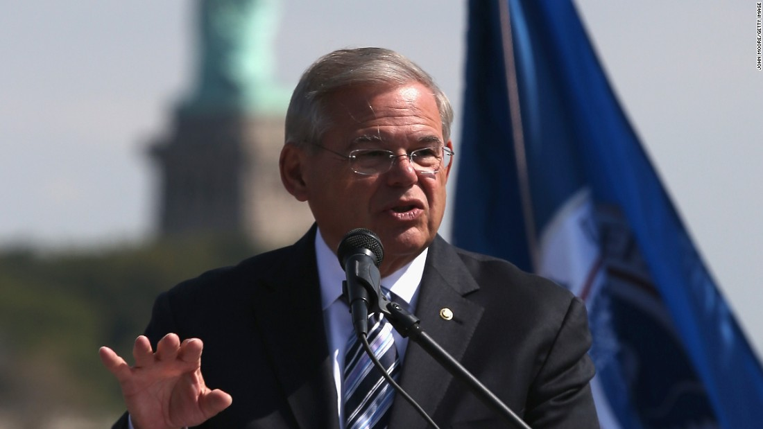 U.S. Senator Robert Menendez (D-NJ) speaks in front of the Statue of Liberty at a naturalization ceremony at Liberty State Park on September 19, 2014 in Jersey City, New Jersey.