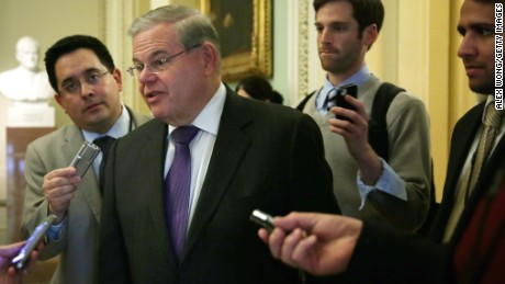 U.S. Sen. Robert Menendez (D-NJ) talks to reporters as he arrives at the weekly Senate Democratic Policy Committee luncheon March 25, 2014 at the Capitol in Washington, DC. Senate Democrats held its weekly policy luncheon to discuss Democratic agenda.