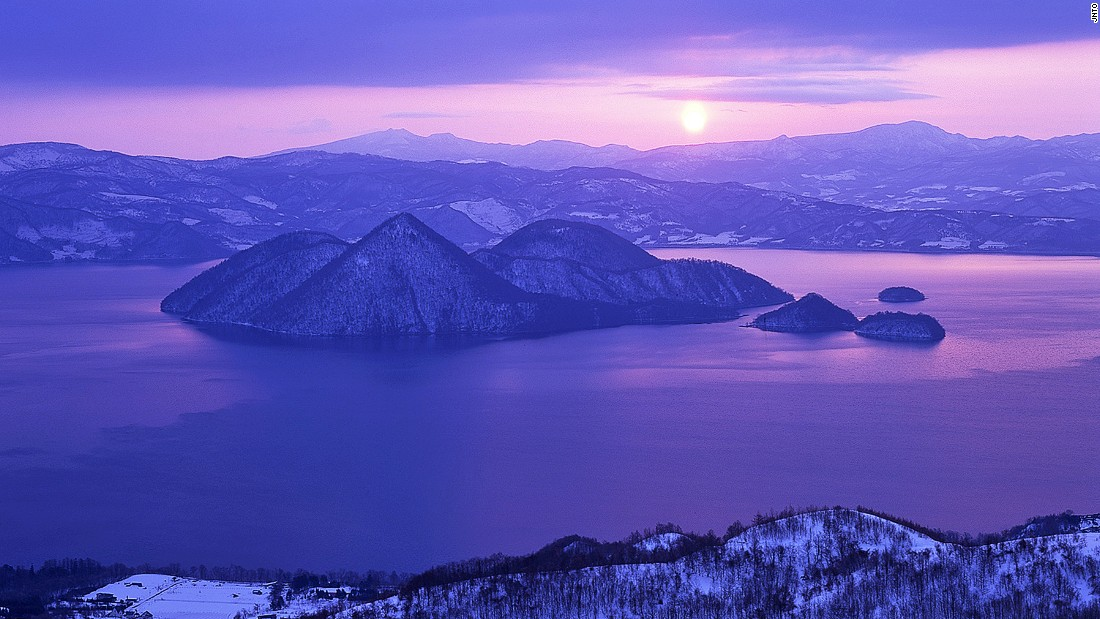 """Even in winters that plummet well below freezing point, Lake Toya never ices over. <br />The near-circular lake is the remains of a volcanic eruption that hollowed out the ground. <br />Mount Usu lies on the southern rim of the lake and Nakajima Island sits at the center.<em><br /><a href=""""http://www.toyako-vc.jp/en/"""" target=""""_blank"""">Shikotsu-Toya National Park</em></a><em>, Toyako, Hokkaido, Japan; +81 142 75 2555</em>"""
