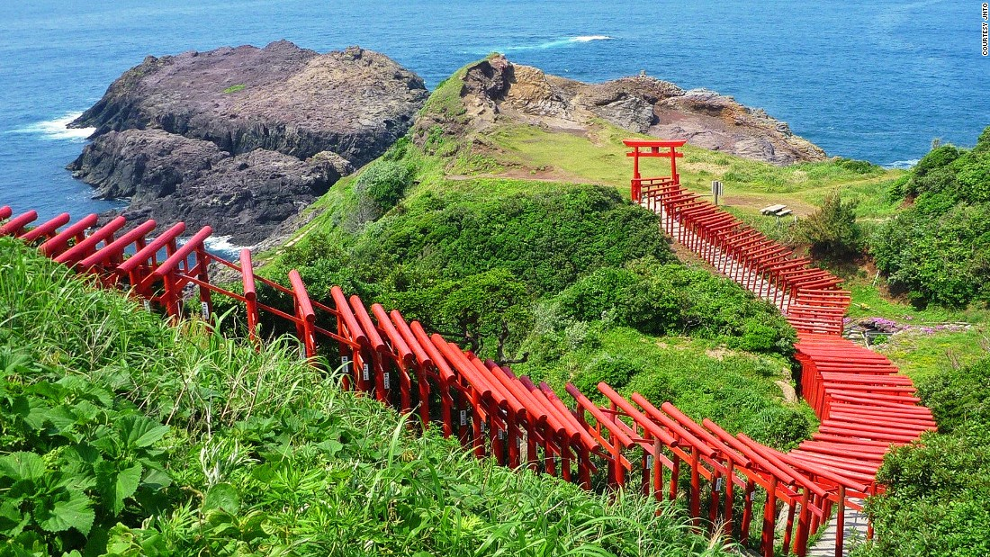 """The 123 Torii gates stretches from the Motonosumi-Inari Shrine to the cliff overlooking the ocean.<br />Motonosumi-Inari is a popular shrine where locals wish for success.<br />The final Torii's donation box is placed out of reach at the top of the gate. It's believed that if you can successfully toss money into the box, all your wishes will come true.<em><br /><a href=""""http://www.nanavi.jp/page/detail.php?id=310"""" target=""""_blank"""">Motonosumi-Onari Shrine</em></a><em>, 498 Yuyatsuo, Nagato, Yamaguchi, Japan; +81 837 23 1137</em>"""