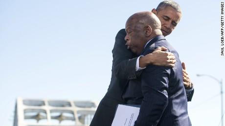 Obama hugs U.S. Representative John Lewis, one of the original marchers at Selma.