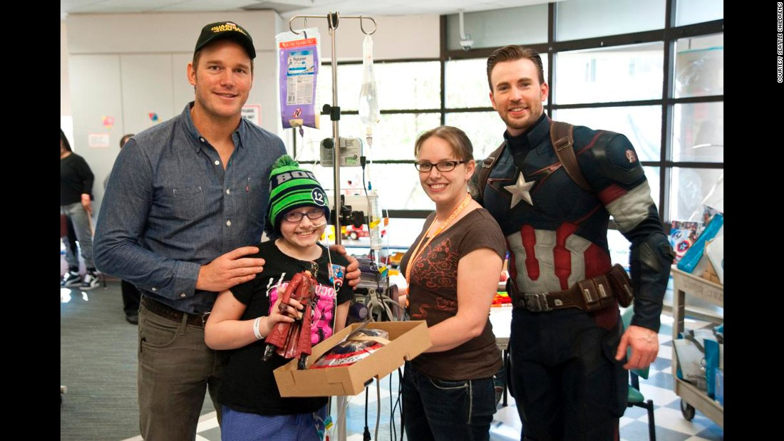Marvel movie stars Chris Pratt, left, and Chris Evans visit young patients at Seattle Children's Hospital on Saturday as part of a Super Bowl bet in which everyone was a winner.