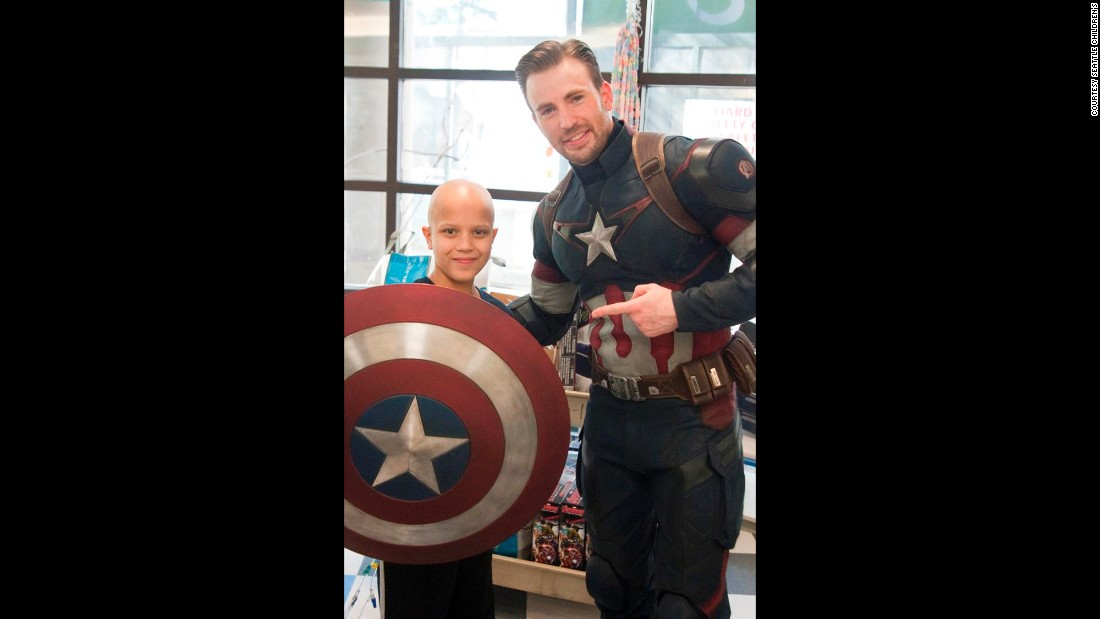 Evans showed up in full Captain America regalia bearing gifts for the young patients.