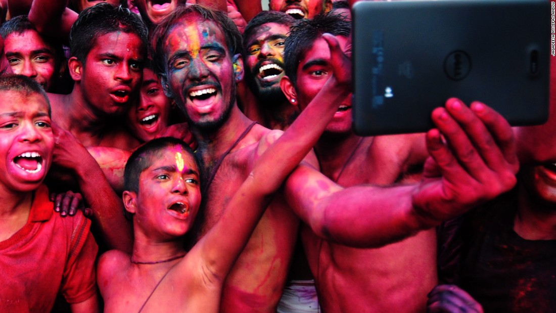 "People smeared with color take a photo Friday, March 6, during the Holi festival in Bangalore, India. <a href=""http://www.cnn.com/2015/03/06/world/gallery/holi-2015/index.html"" target=""_blank"">The Holi festival of colors</a> is a Hindu celebration marking the arrival of spring."