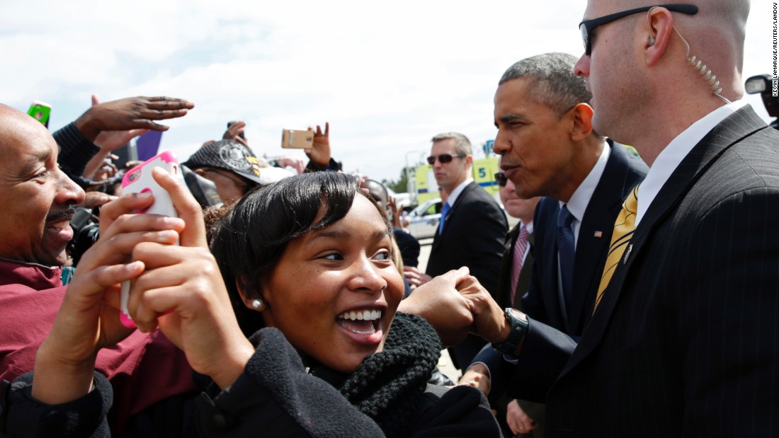 A girl takes a selfie as U.S. President Barack Obama greets supporters in Columbia, South Carolina, on Friday, March 6.