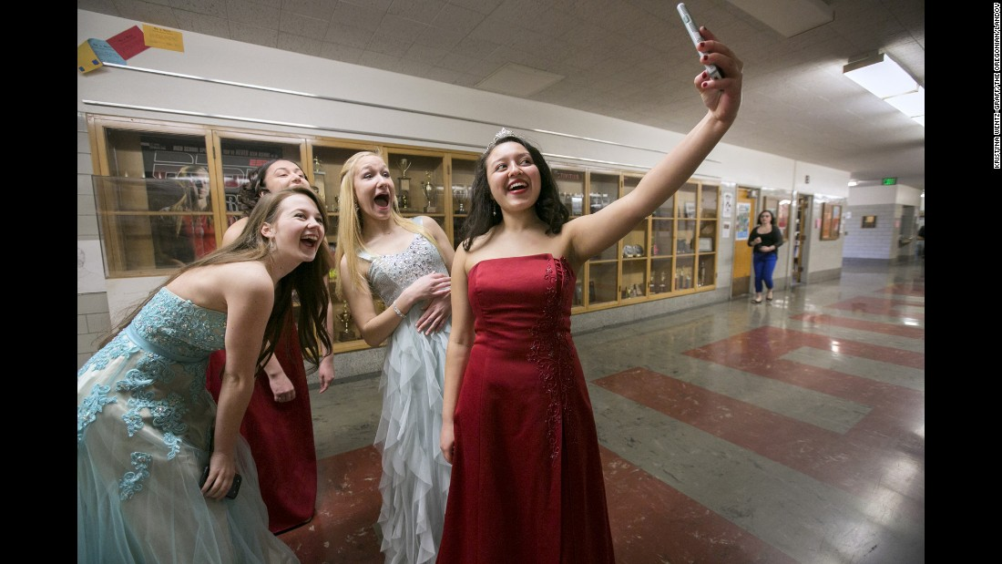 Jasnery Valenzuela, the outgoing Rose Festival princess for Portland, Oregon's Lincoln High School, takes a selfie with this year's princess candidates on Thursday, March 5.