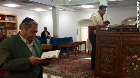 Jewish community leader Michael Malakon (R) leads prayers at the main synagogue in Esfahan, Iran.