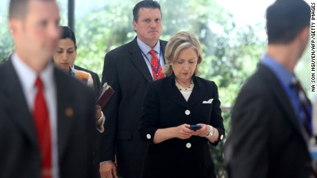 US secretary of state Hillary Clinton (C) looks at her mobile phone after attending a Russia - US meeting on the sidelines of the 43rd annual Association of South East Asian Nations (ASEAN) Ministering Meeting in Hanoi on July 23, 2010.
