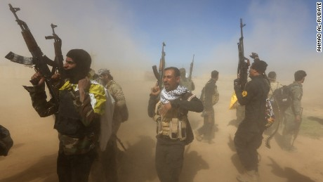 Caption:Iraqi fighters of the government-controlled Popular Mobilisation units take part in a military operation to take control of Tikrit, 160 kms north of Baghdad, from jihadists from the Islamic state (IS) group, on March 11 2015. The city, which is the home town of former president Saddam Hussein, is the toughest target for the government troops and allied militias that started winning back lost ground last year. AFP PHOTO / AHMAD AL-RUBAYE (Photo credit should read AHMAD AL-RUBAYE/AFP/Getty Images)