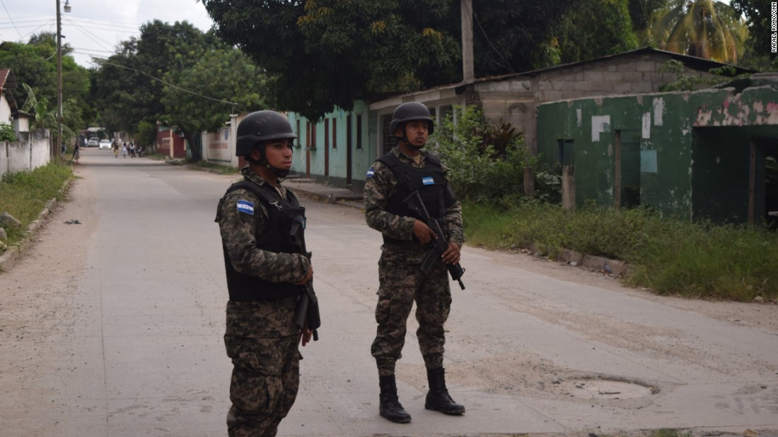 Members of the Honduran Military Police patrol the Chamelecón neighborhood in San Pedro Sula, the city with the highest murder rate in the world.