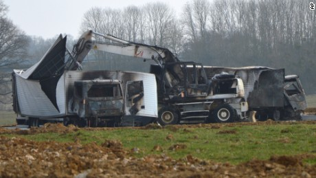 Burnt out vans are seen near the Avallon motorway exit, central France, Wednesday, March 11, 2015. A police official says 15 armed assailants attacked two vans on a French highway carrying millions of euros worth of jewels, and sped away. The official says the two vans were found burned in a forest near the site of the attack, which happened on the A6 highway connecting Paris and Lyon. The jewels were not found. (AP Photo)