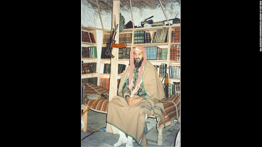 Bin Laden sits in front of his bookshelves inside his Tora Bora hideout. His three wives and more than a dozen children struggled with the sparse amenities. The only heat came from a wood-burning stove.