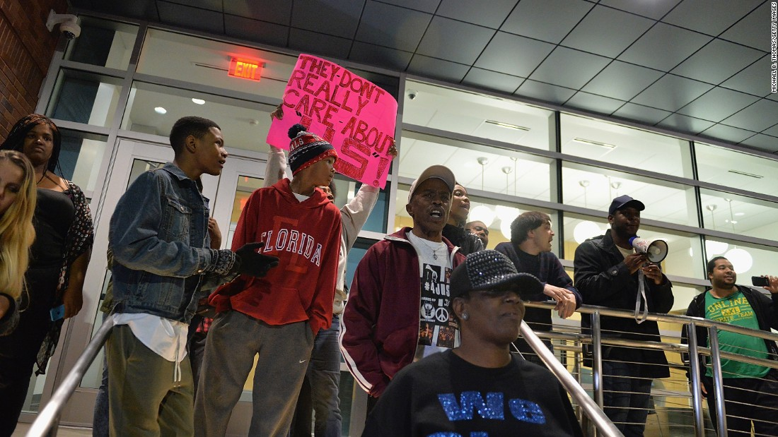Protesters demonstrate outside the police station on Wednesday, March 11. Some gathered to cheer the resignation of police Chief Thomas Jackson. Others amassed to demand more: the disbanding of the entire police department and the resignation of Mayor James Knowles.