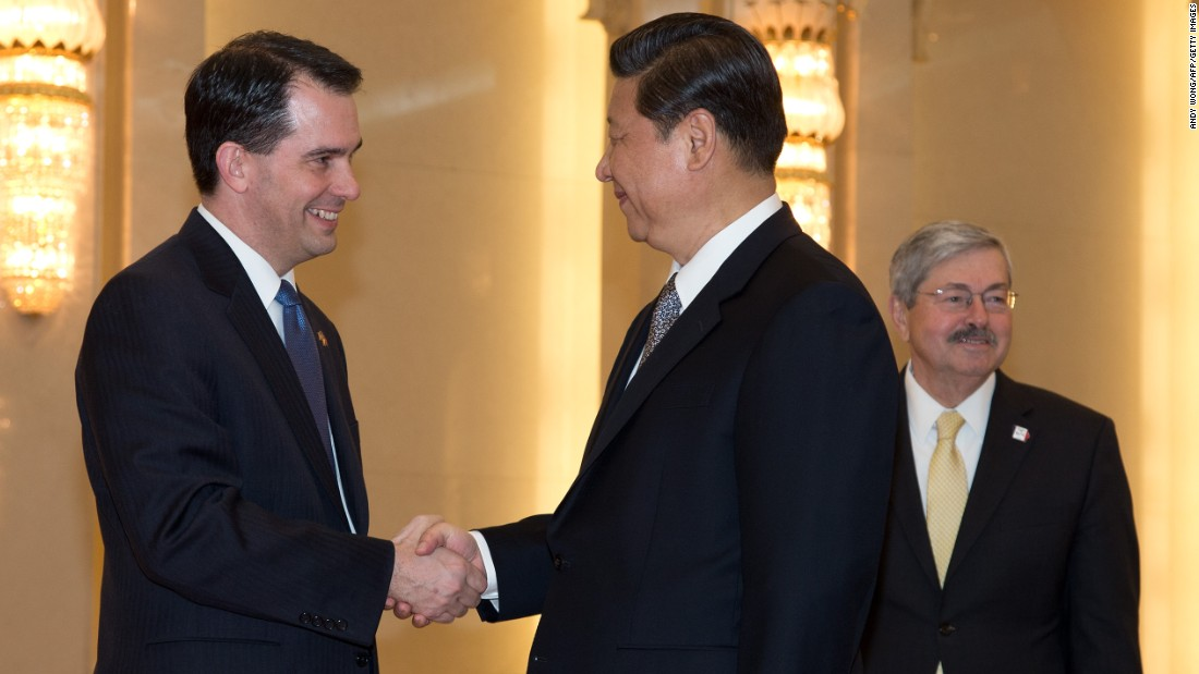 Scott Walker (left) shakes hands with Chinese President Xi Jinping (center) before a meeting as Iowa Governor Terry Branstad (right) looks on at the Great Hall of the People in Beijing on April 15, 2013.