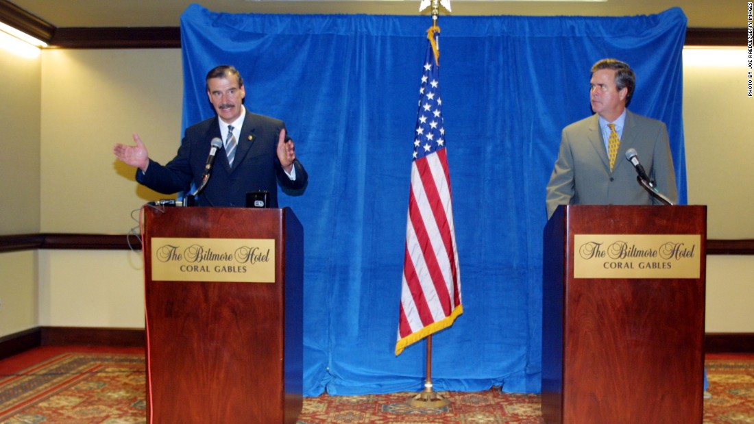 Then-Mexican President Vincente Fox (left) and Bush hold a press conference September 7, 2001, in Miami. Fox visited Florida to attend the Americas Conference and deliver a speech to speak about issues such as immigration.