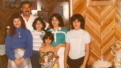 Dressed in a dancing costume, Zayid poses with her parents and siblings.