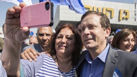 A supporter takes a selfie with Israeli Labor Party leader, Isaac Herzog (R), during his campaign visit to southern coastal Israeli city of Ashdod, on March 13, 2015.