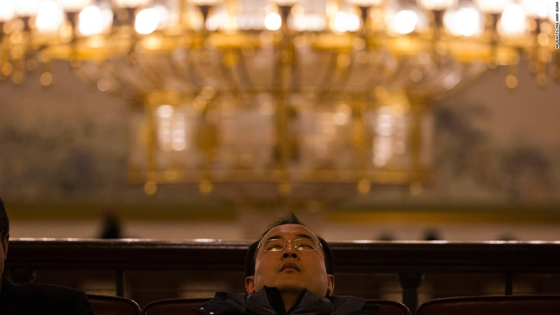 "MARCH 13 - BEIJING, CHINA: A man naps in the corridor of the Great Hall of the People during a plenary session of the <a href=""http://money.cnn.com/2015/03/10/news/economy/china-billionaire-parliament/"">National People's Congress.</a> The annual gathering is <a href=""http://money.cnn.com/2015/03/10/news/economy/china-billionaire-parliament/"">long on pomp and circumstance but short on legislative deliberation;</a> while some voting takes place, the Communist Party's proposals are always approved."