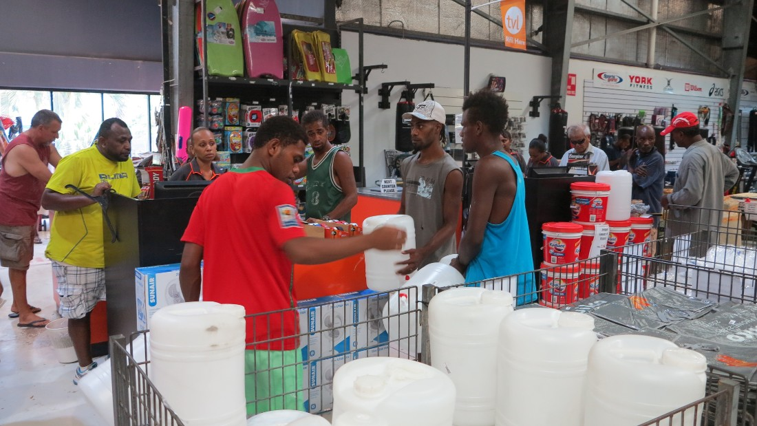 People in Port Vila buy supplies ahead of the storm on March 12.