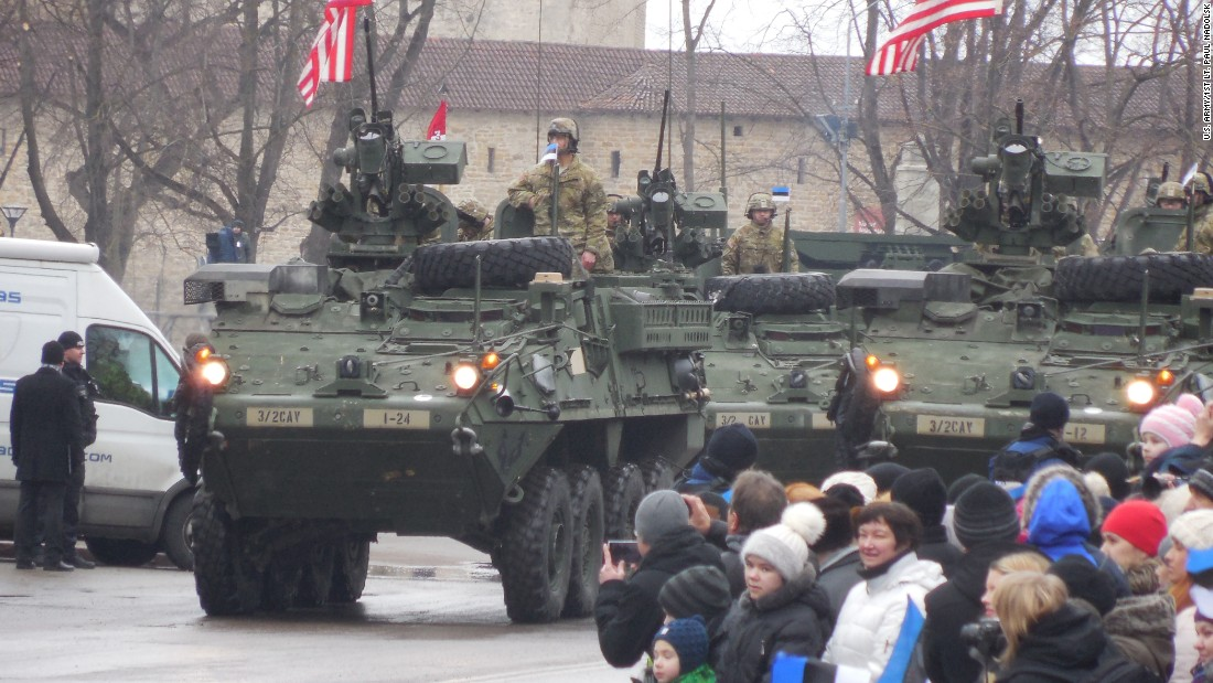 Soldiers of Iron Troop, 3rd Squadron, 2nd Cavalry Regiment rider Strykers through the Estonian Independence Day parade in February.
