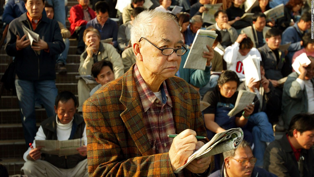 "Perhaps considering the maxim, ""by failing to prepare, you are preparing to fail,"" an elderly punter calmly ponders his racing form at the Hong Kong International Races."