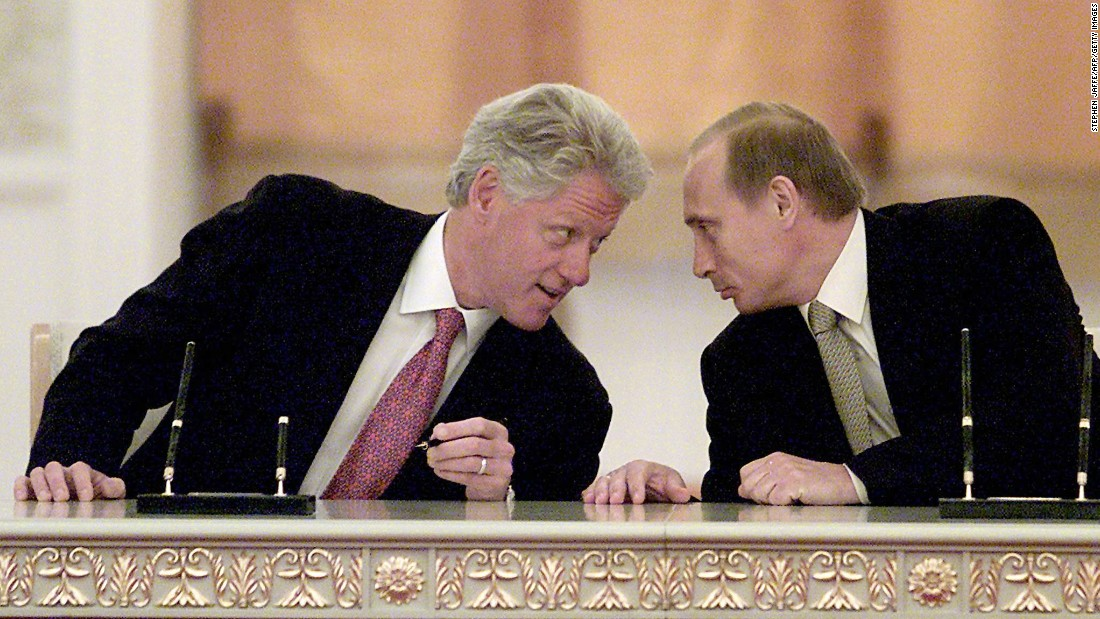 Putin and U.S. President Bill Clinton talk in Moscow in June 2000.