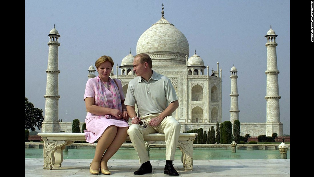 Putin speaks to his wife, Lyudmila, as they pose in front of the Taj Mahal in India in October 2000.