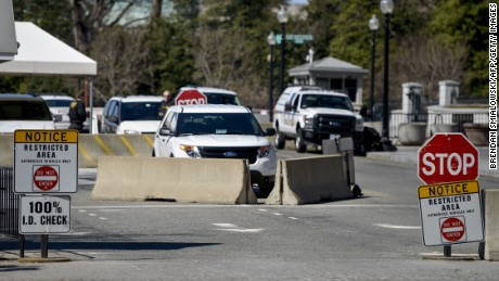 A checkpoint at 15th Street to enter the White House grounds is seen March 12, 2015 in Washington, DC. The US Secret Service is investigating claims that some of its agents crashed a car into White House security barriers after a night out, The Washington Post reported March 11. The Secret Service was not immediately available to confirm the report, but spokesman Brian Leary told the Post that the probe would be conducted by the Department of Homeland Security's inspector general.