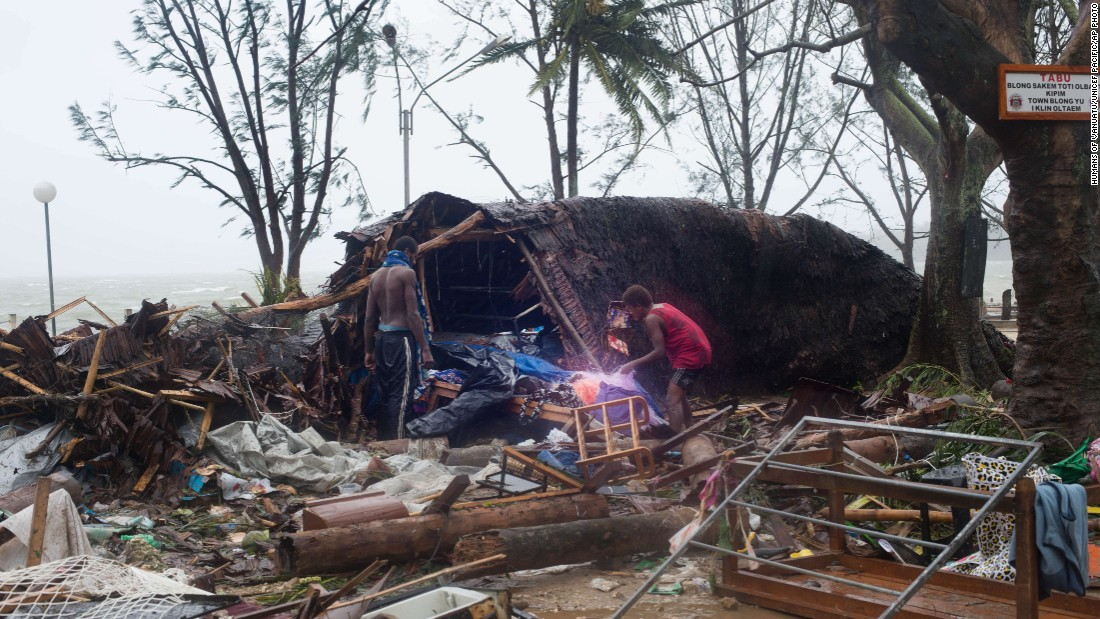 Residents look through storm damage in Port Villa on March 14.