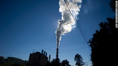 A plume of exhaust extends from the Mitchell Power Station, a coal-fired power plant located 20 miles southwest of Pittsburgh, on September 24, 2013 in New Eagle, Pennsylvania. The plant, owned by FirstEnergy, will be one of two plants in the region to be shut down, affecting 380 employees. The Evironmental Protection Agency (EPA) and the Obama administration have been taking major steps to get coal-fired power plants into compliance with clean air regulations. (Photo by Jeff Swensen/Getty Images)